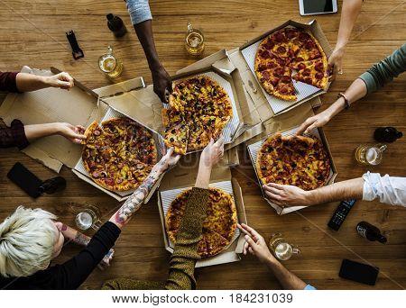 People Hands Grabbing Slice of Pizza