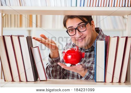 Young student in expensive textbooks concept