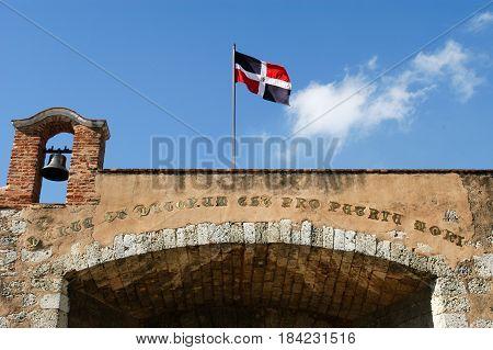 Santo Domingo, Dominican Republic - 3 february 2002: Colonial door with dominican flag at Santo domingo on Dominican Republic