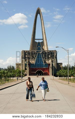 Higuey, Dominican Republic - 30 january 2002: woman walking in front of the church named