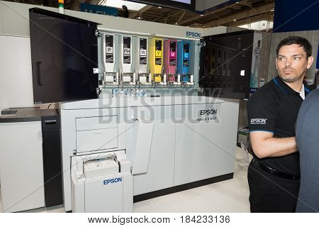Hannover Germany - March 22 2017: Epson presents paperlab a8000 recycling machine at CeBIT 2017. CeBIT is the world's largest trade fair for information technology.
