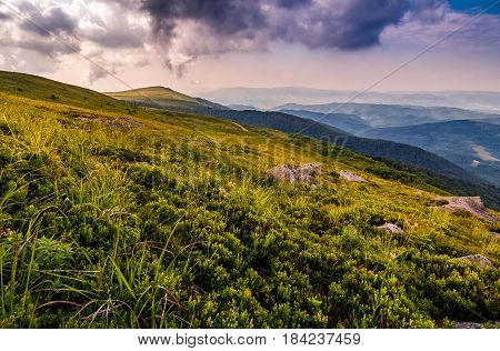 Stones On The Edge Of Mountain Hillside At Sunset