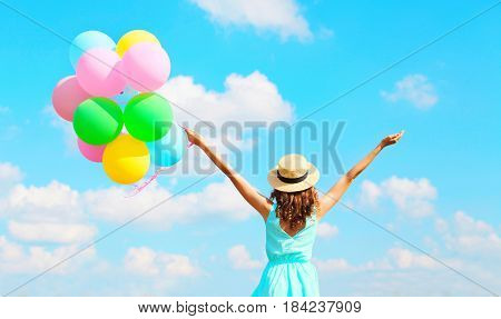 Back View Happy Woman With An Air Colorful Balloons Is Enjoying A Summer Day On A Blue Sky Backgroun