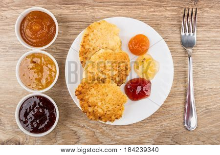 Cottage Cheese Pancakes With Jam In Plate, Bowl With Jam