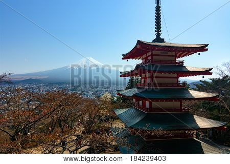 FUJIKAWAGUCHIKO, JAPAN - APRIL 14, 2017 - The famous five-storied Chureito Pagoda stands in front of Mount Fuji on a warm spring day in Japan