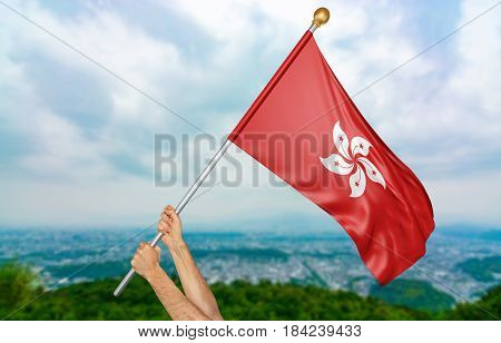 Young man's hands proudly waving the Hong Kong national flag in the sky, part 3D rendering