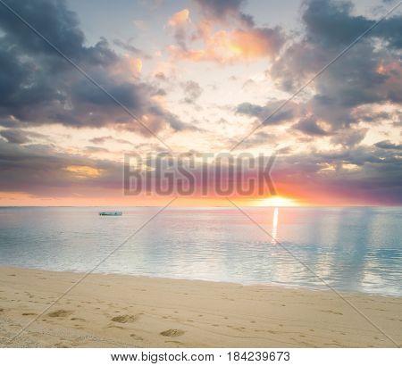 Sandy tropical beach at sunset.  Mauritius