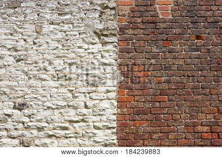 architectural background of red brick and white stone wall of an old barn