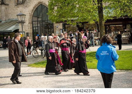 Altoetting,Germany-May 1,2017: A group of bishops and cardinals talk after mass
