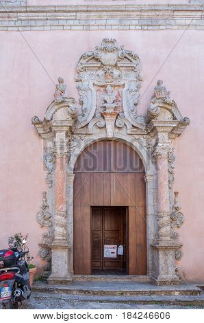 ERICE ITALY - SEPTEMBER 12 2015: Old decorative door of a church in Erice Sicily southern Italy
