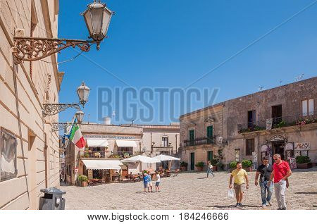 ERICE ITALY - SEPTEMBER 12 2015: Main square of Erice with touristic shops and restaurants near Trapani Sicily southern Italy