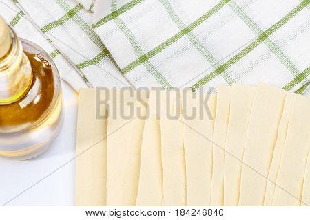 dried uncooked lasagna pasta sheets on dishcloth