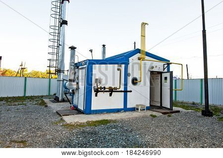Gas boiler house with high steel pipe