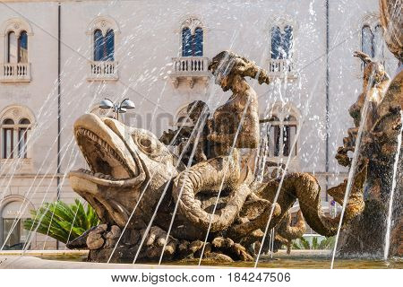 The fountain on the square Archimedes in Syracuse. Sicily Italy