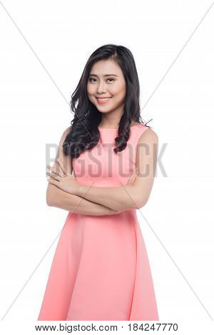 Asian Young Beautiful Woman With Long Black Hair In Pink Dress Standing Over White.