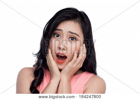 Surprised Face Of Young Asian Woman Over White.