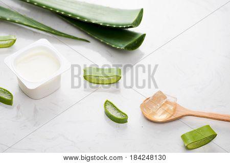 Aloe Vera Yogurt With Fresh Leaves On A Wooden Table
