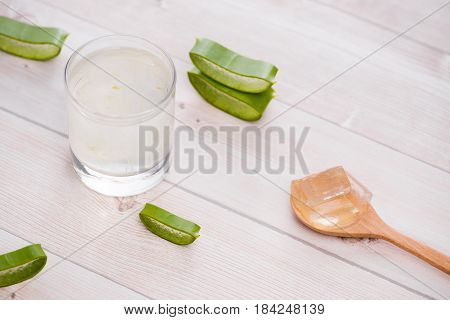 Glass Of Aloe Vera Juice With Slices On A Wooden Table