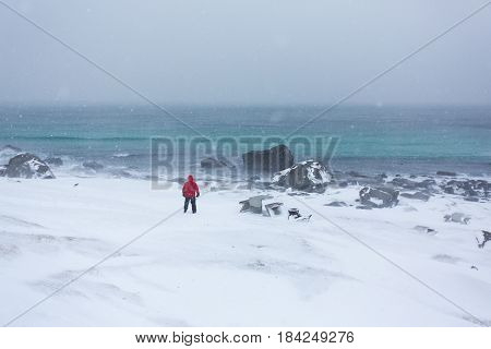 The lonely man on the coast during the snowstorm