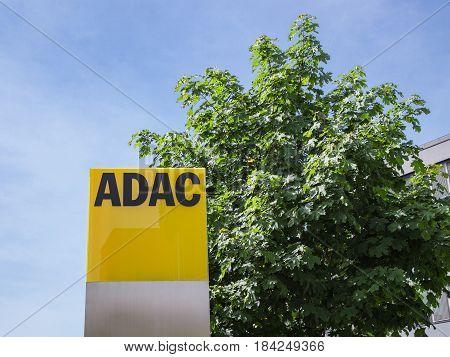 Munich Germany - May 12 2015: ADAC signage with German automobile club logo largest automobile association in Europe.