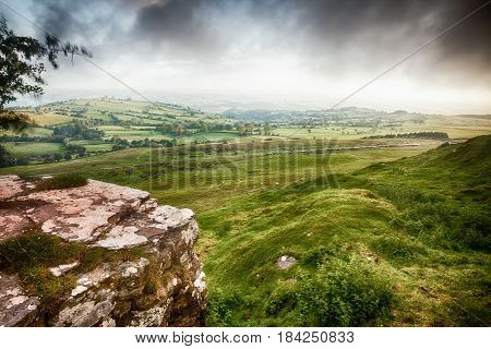 Brecon Beacons landscape view across the green hills and rock outcrops Cloudy weather and windy