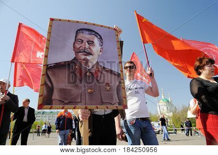 Orel Russia - May 1 2017: May demonstration. Young men with Stalin portrait and red Communist flags around