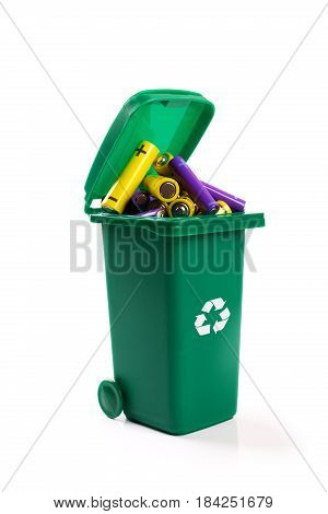hazardous waste recycling - green wheelie bin full with batteries