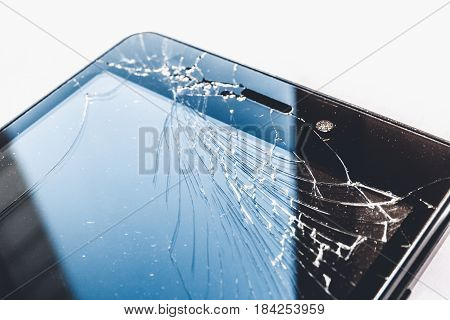 Smartphone or cell pone with broken screen close up