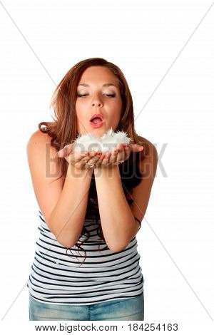 Dreaming beautiful woman with falling feathers over white background