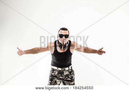 charismatic DJ - rapper with headphones on a white background.the photo has a empty space for your text