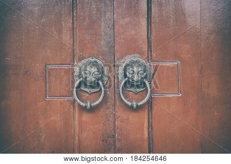 Chinese wooden door with lion head knocker architecture