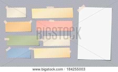 White, colorful blank note, notebook, copybook sheet stuck with sticky tape on squared grey background.