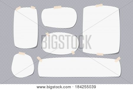 White blank note, notebook, copybook sheet with rounded corners stuck with sticky tape on squared grey background.
