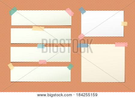 Light blank note, notebook, copybook sheet stuck with colorful sticky tape on squared orange background.