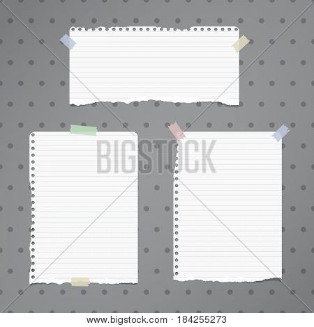 White ripped ruled notebook, copybook sheets stuck with sticky tape on grey dotted pattern.