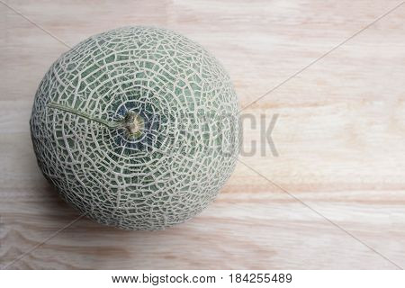 Fresh Green Melon fruit Cantaloupe top view on wooden table