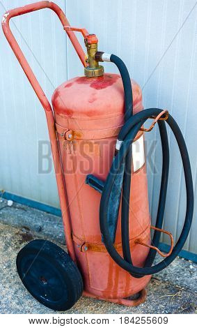 old fire extinguisher on wheels in poor condition