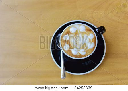 Top view a cup of coffee cappuccino art latte art Hot latte cappuccino on wooden table in cafe