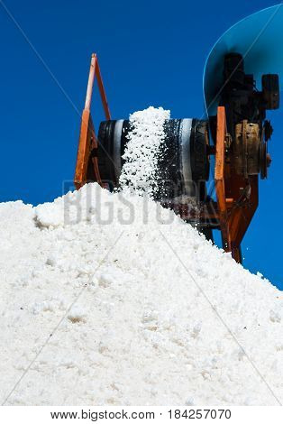 conveyor belt with salt harvested in the saline of Trapani Sicily. ITALY