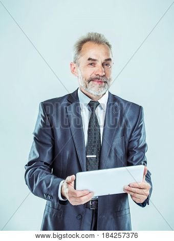 successful businessman with digital tablet on light background.the photo has a empty space for your text