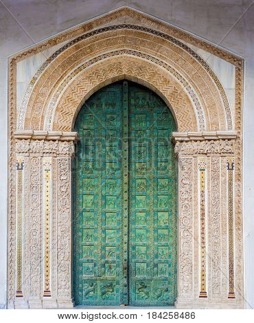 bronze door the facade of the cathedral of Monreale Sicily - Italy