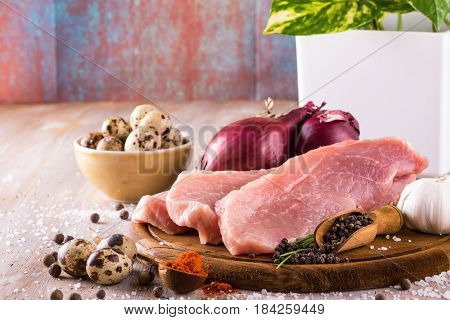 Raw Pork Meat With Few Spices And Vegetable