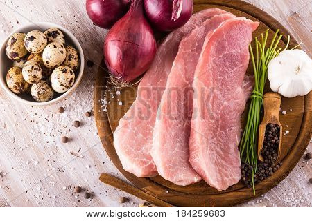 Top View On Raw Pork Meat With Few Spices And Eggs