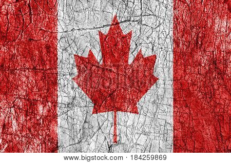 Grudge stone painted Canada flag close up