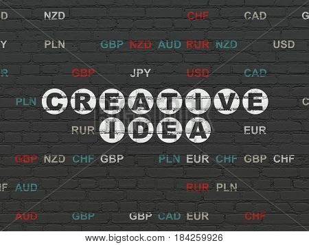 Finance concept: Painted white text Creative Idea on Black Brick wall background with Currency