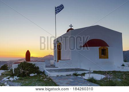 Church near Agia Marina village on Leros island in Greece at sunset.