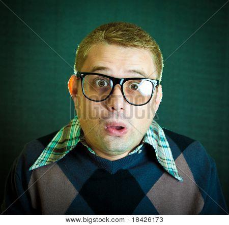 Portrait of the funny surprised nerd guy