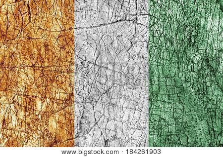 Grudge stone painted Cote d'lvoire flag close