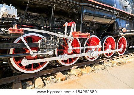 Vintage steam locomotive engine wheels and rods details