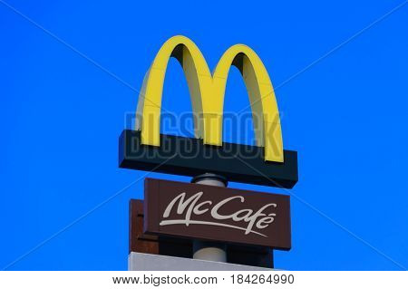 Krakow Poland - 30 April 2017: Large McDonald's and McCafe Restaurant sign. McDonald's is the world's largest chain of hamburger fast food restaurants.